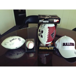 Footballs signed by MSU players and coaches & a ball and baseball cap signed by coach John Cohen!